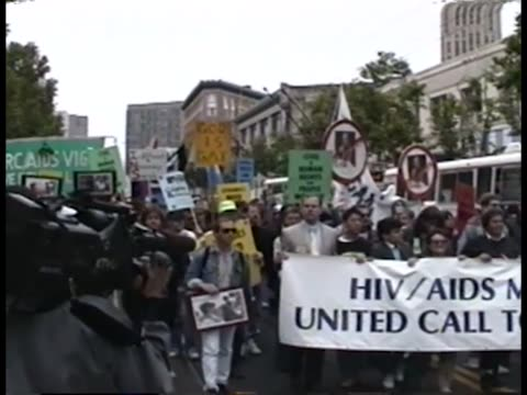 Protesters marching at a unity rally for ACT UP during the 6th Annual International AIDS Conference