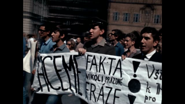 protesters marching carrying banners and signs to confront soviet troops at the height of the prague spring invasion - czech culture stock videos & royalty-free footage