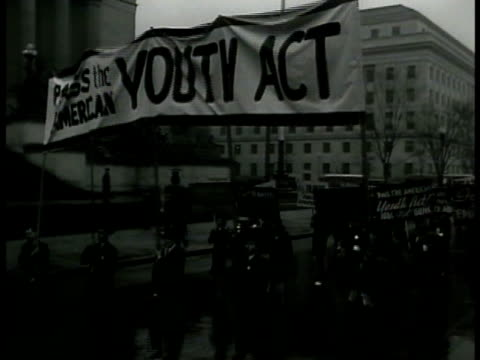 protesters marching on washington dc streets banner 'pass the american youth act' vs people walking holding homemade signs 'no to war tools yes to... - 1940 stock videos & royalty-free footage