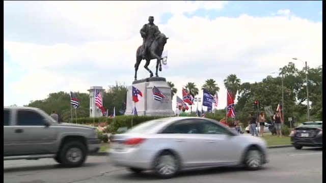 vídeos y material grabado en eventos de stock de protesters, members of the monumental task committee, in front of the p.g.t. beauregard monument, which was the third of four confederate monument... - monumento