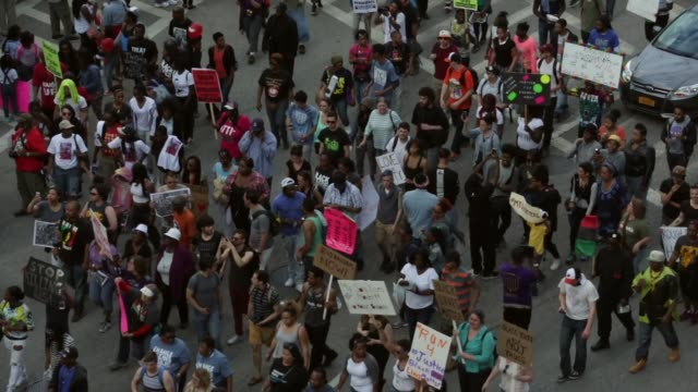 protesters move to a street next to the city hall for a march to the sandtown-winchester neighbourhood after a rally held by black lawyers for... - maryland us state stock videos & royalty-free footage