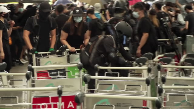 protesters occupying hong kong international airport - hong kong international airport stock videos & royalty-free footage