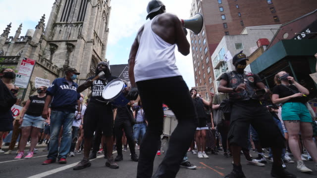 protesters of george floyd's death gather to demonstrate peacefully march to the union square at new york city ny usa at 5:00 pm. the demonstrators... - dancer stock videos & royalty-free footage