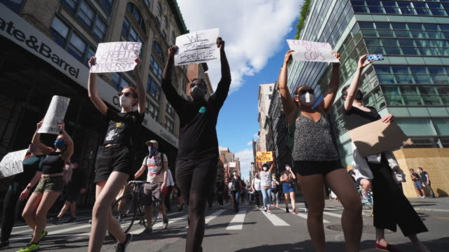 protesters of george floyd's death, who demonstrate peacefully march on the broadway at soho to the city hall in new york city ny usa at 05:00 pm on... - multiracial group stock videos & royalty-free footage