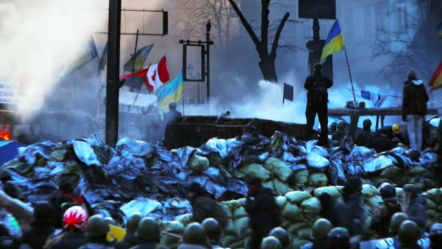 protesters on barricades in kiev - euromaidan - violence stock videos & royalty-free footage