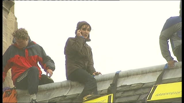 protesters on roof pulling ladder up environmental activists on roof showing 'change politics save the climate' banners anita jones interview as... - greenpeace stock videos & royalty-free footage