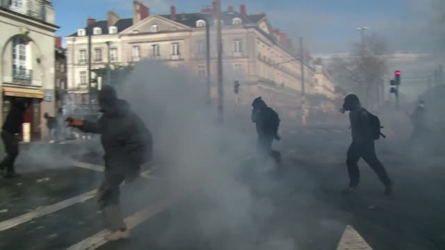 protesters opposed to plans to build a new airport for the french city of nantes smashed shop windows saturday and hurled paving stones at police,... - nantes stock videos & royalty-free footage