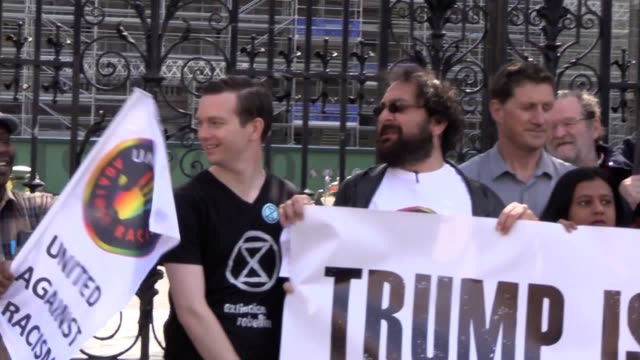 protesters opposed to us president donald trump's visit to ireland later this week staged a photocall outside the irish parliament in dublin to... - uludag stock videos and b-roll footage