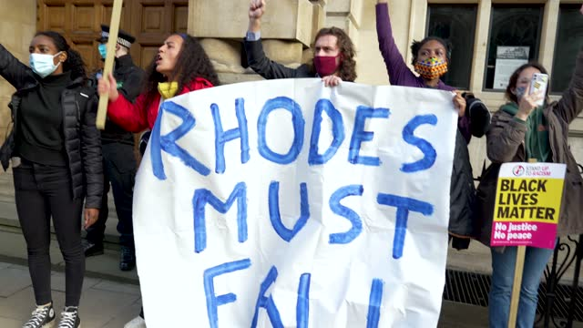 protesters outside the cecil rhodes statue at oxford university on may 25, 2021 in oxford, england. today marked the first anniversary of the death... - oxford england stock videos & royalty-free footage