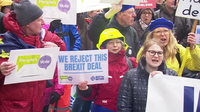 protesters outside the houses of parliament demonstrating in favour of a people's vote for brexit - european union stock videos and b-roll footage
