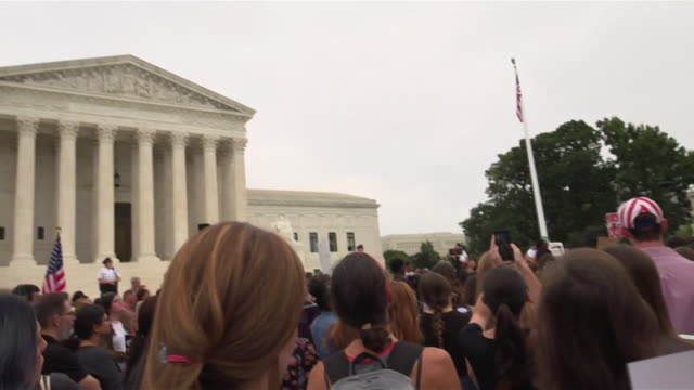 protesters outside the us supreme court building booing and chanting shame after hearing brett kavanaugh has been confirmed to the supreme court - us supreme court building stock videos and b-roll footage