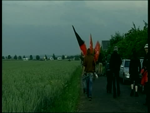 protesters participate in a demonstration during the 2007 g8 summit in rostock laage germany - (war or terrorism or election or government or illness or news event or speech or politics or politician or conflict or military or extreme weather or business or economy) and not usa stock-videos und b-roll-filmmaterial