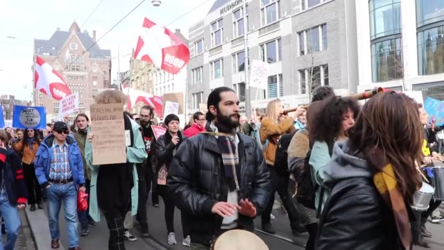 protesters participate in a protest march against racism and discrimination between dokwerker and dam square in amsterdam netherlands on march 23 2019 - protestor stock videos & royalty-free footage