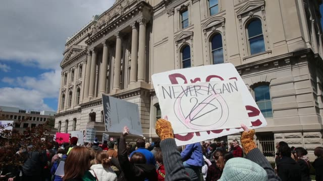 Protesters participate in the Rally for Women's Rights on the south lawn of the Indiana Statehouse April 9 2016 in Indianapolis Ind The protest was a...