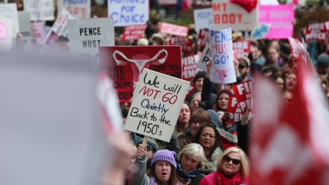 protesters participate in the rally for women's rights on the south lawn of the indiana statehouse, april 9, 2016 in indianapolis, ind. the protest... - choice stock videos & royalty-free footage