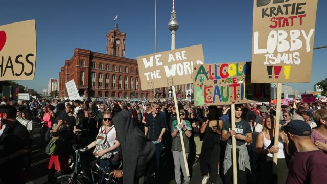 protesters participate in the unteilbar march against racism exclusion and exploitation and for an open society on october 13 2018 in berlin germany... - rassismus stock-videos und b-roll-filmmaterial