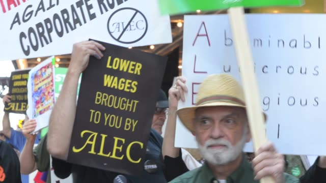 / Protesters picket outside the Palmer House Hilton Hotel where The American Legislative Exchange Council hold their 40th anniversary convention /...