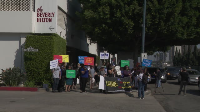 protesters protest during oscar lunch over hispanic representation in hollywood. - mittagessen stock-videos und b-roll-filmmaterial