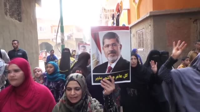 protesters raise their hands with the rabia gesture and hold posters of former president of egypt mohamed morsi during a demonstration against... - president of egypt stock videos & royalty-free footage