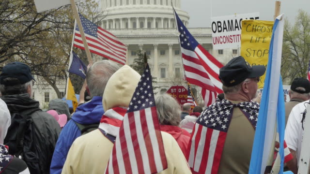 protesters rally against obamacare at us capitol building on march 24, 2012 in washington, dc - 憲法点の映像素材/bロール