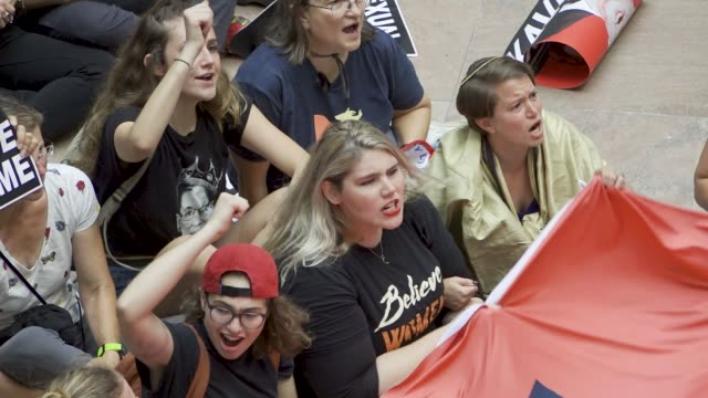 stockvideo's en b-roll-footage met protesters rally against supreme court nominee judge brett kavanaugh on thursday october 04 2018 in washington dc demonstrators marched to the us... - {{relatedsearchurl(carousel.phrase)}}