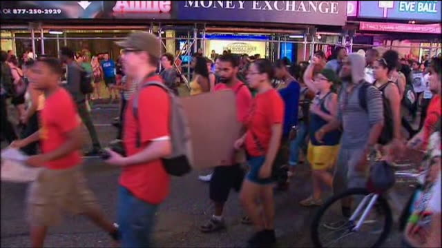 protesters rally against the acquittal of george zimmerman for the murder of trayvon martin in times square new york city - crime or recreational drug or prison or legal trial stock-videos und b-roll-filmmaterial