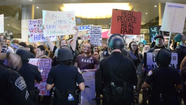 protesters rally against the muslim immigration ban imposed by u.s. president donald trump at los angeles international airport on january 29, 2017... - forbidden stock videos & royalty-free footage