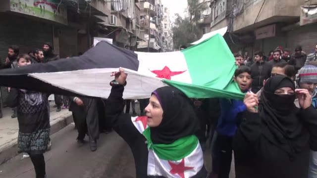 protesters rally in aleppo syria on friday in favour of the free syrian army and against the alqaeda linked islamic state in iraq and the levant... - al qaida stock videos & royalty-free footage