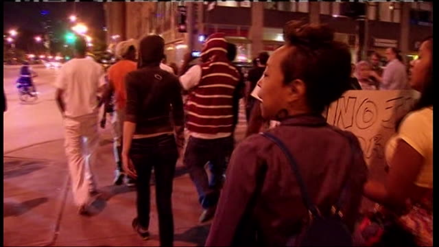 protesters rally in chicago after george zimmerman is acquitted for the murder of trayvon martin - crime or recreational drug or prison or legal trial stock-videos und b-roll-filmmaterial