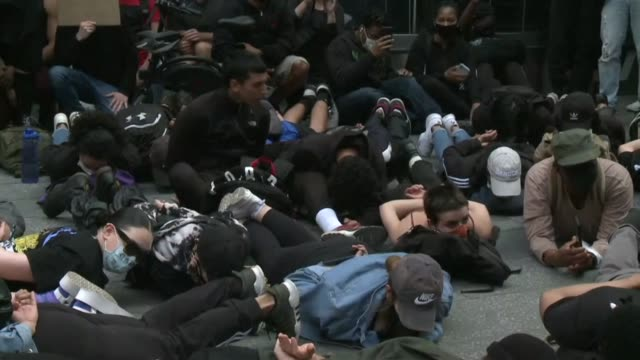 protesters reenact the arrest of george floyd as they rally in times square, new york to demand justice over the death of unarmed black man george... - new york stato video stock e b–roll