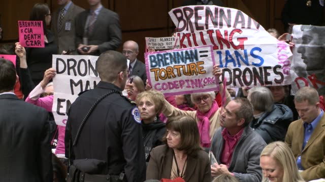 protesters repeatedly disrupt the senate hearing to confirm the new cia director john brennan testifies at intelligence committee at us senate hart... - waterboarding stock videos & royalty-free footage