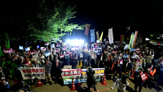 """protesters returned to the front of the national diet building to voice their concerns about what they branded the government's contentious war law""""... - japan self defense forces stock videos and b-roll footage"""