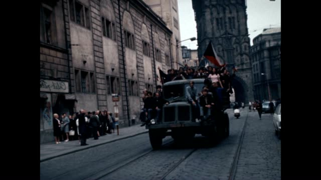 Protesters riding to confront Soviet troops at the height of the Prague Spring invasion