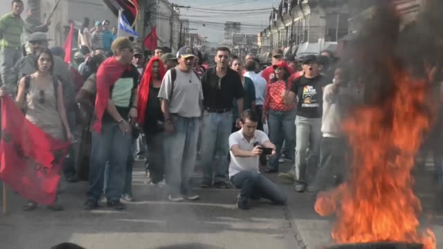 Protesters set up barricades on the Mallol bridge which connects the Hoonduran cities of Tegucigalpa and Comayaguela during a day of strike to demand...