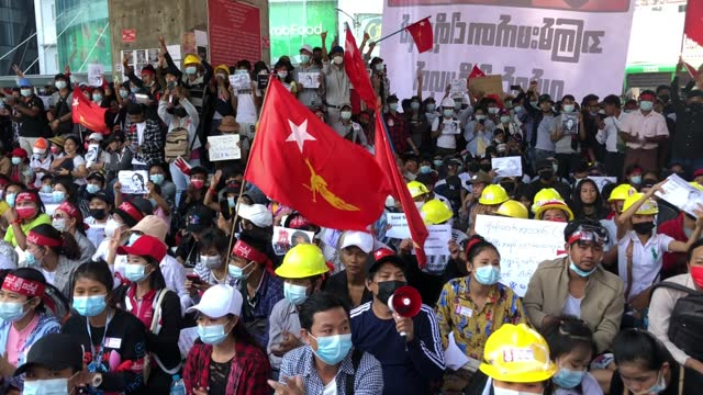 protesters shout slogans on february 10 in yangon, myanmar. myanmar declared martial law in parts of the country, including its two largest cities,... - ミャンマー点の映像素材/bロール