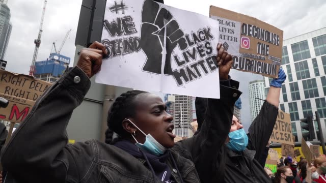 protesters shouts along with other protesters at a black lives matter protest in london on june 7, 2020 in london, united kingdom. the death of an... - video stock videos & royalty-free footage