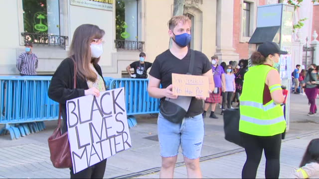 protesters shouts slogans at u.s embassy in madrid during a demonstration against racism and in solidarity with the black lives matter movement, in... - togetherness stock videos & royalty-free footage