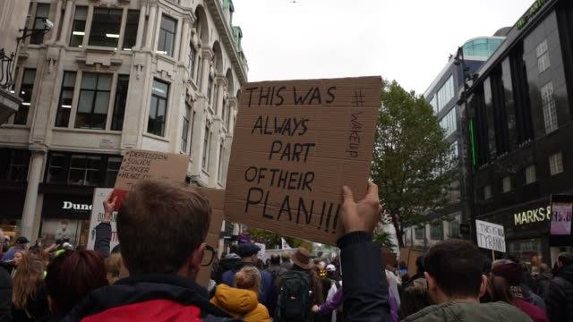 protesters show a lack of social distancing during a unite for freedom march on october 24, 2020 in london, england. hundreds of anti-mask and... - slow stock videos & royalty-free footage