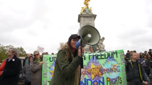 protesters show a lack of social distancing during a unite for freedom march on october 24, 2020 in london, england. hundreds of anti-mask and... - conspiracy stock videos & royalty-free footage