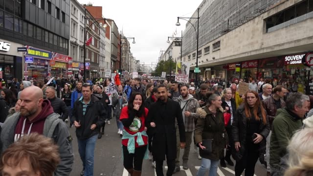 protesters show a lack of social distancing during a unite for freedom march on october 24, 2020 in london, england. hundreds of anti-mask and... - pandemic illness stock videos & royalty-free footage