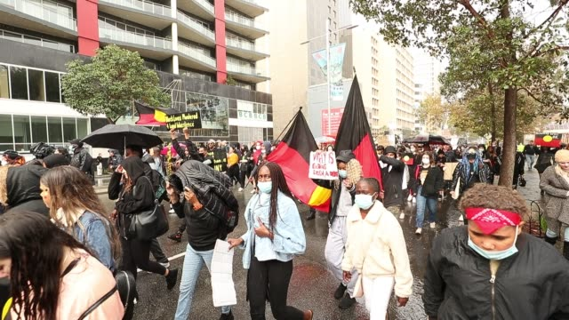 protesters show their support during the black lives matter rally and march on june 13, 2020 in perth, australia. the event was organized in... - showing stock videos & royalty-free footage