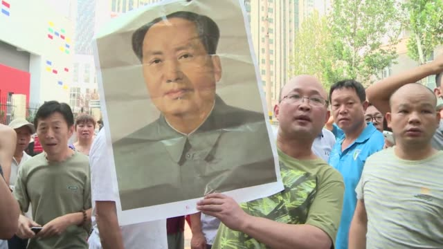 protesters show their support for ousted chinese political star bo xilai outside the court where bo is on trial for bribery embezzlement and abuse of... - legal trial stock videos & royalty-free footage