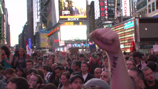 protesters singing in streets of time square during occupy wall street movement audio / new york city, new york, united states - occupy protests stock videos & royalty-free footage