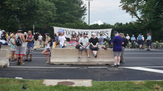 protesters sit on a barrier near the entrance to wells fargo arena on the last day of the democratic national convention. protesters gathered on... - last day stock videos & royalty-free footage