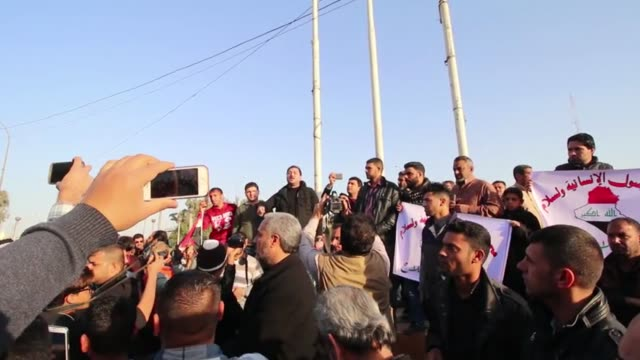 protesters stage a demonstration against corruption in front of the governor's building in basra iraq on january 13 2017 - bassora video stock e b–roll