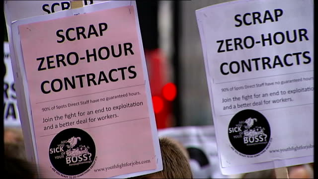 protesters stage rallies outside sports direct over 'zerohours' contracts england london ext low angle shots protesters with banners and placards... - contract stock videos & royalty-free footage