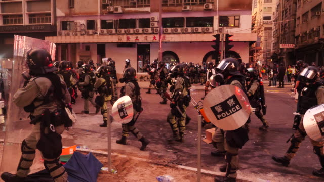 Protesters stop near the Ngau Tau Kok Police Division and setup barriers Police charged protesters made arrests and fired multiple rounds of tear gas...