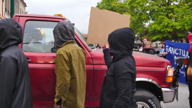 protesters surround a motorist in an old ford pickup truck after he tried to drive through protesters blocking college avenue during a may day day... - ford truck stock videos and b-roll footage