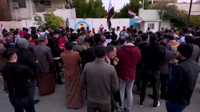 protesters surround the headquarters of the police directorate and the court in the southern shrine iraqi city of karbala to demand the reveil within... - karbala stock videos & royalty-free footage