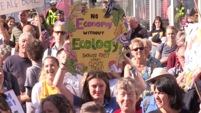 protesters take part in a 'global climate strike' in victoria square birmingham millions of people are taking to the streets across the world in what... - strike protest action stock videos and b-roll footage